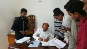 MLA Chinta Prabhakar signing the document