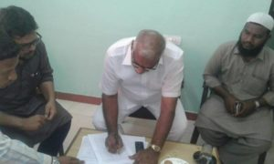 Sirpur MLA Koneru Konappa signing the document